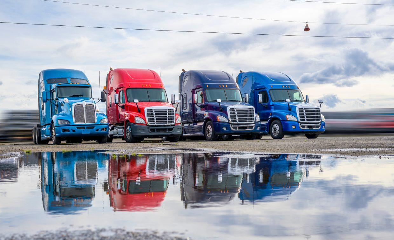 fleet of trucks at parking lot