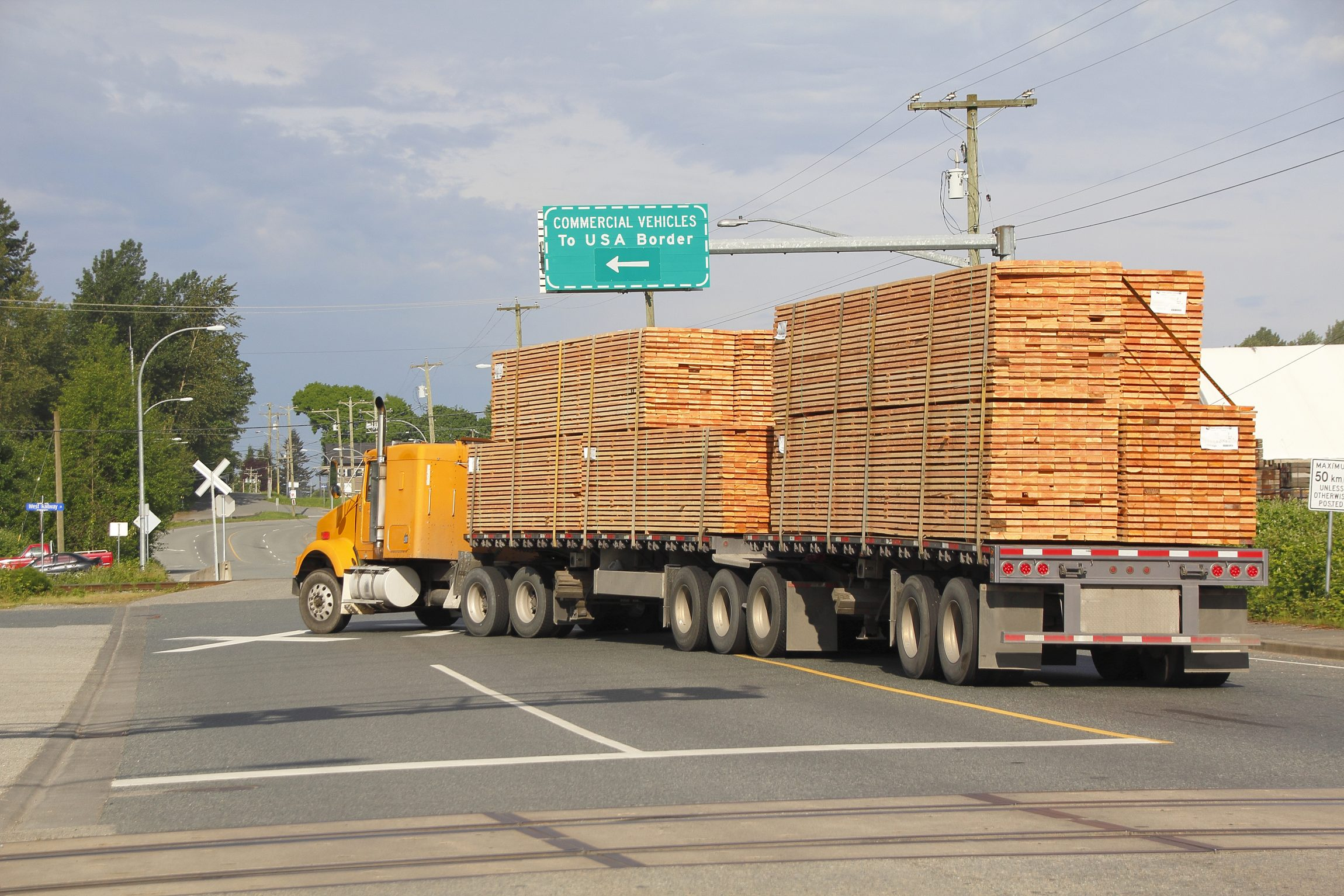 truck loaded with piles of wood